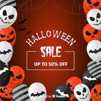 Platte ontwerp van halloween verkoop achtergrond met ballonnen