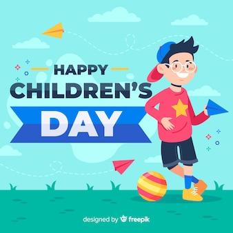 Platte ontwerp van kinderdag met kind buiten spelen