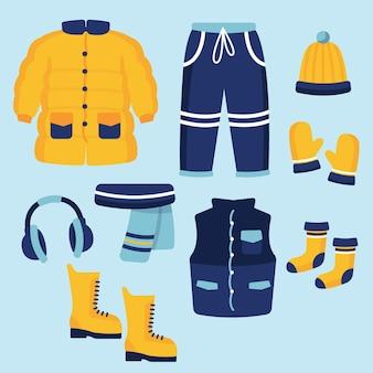 Platte ontwerp winterkleren en essentials
