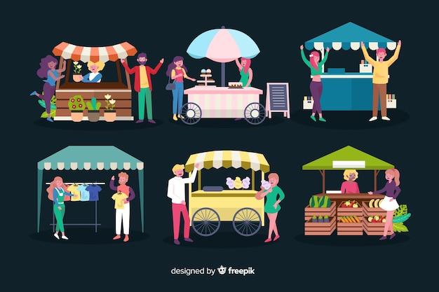 Platte ontwerpmensen bij nachtmarkt
