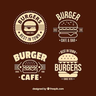 Platte selectie van vier decoratieve hamburgerlogo's