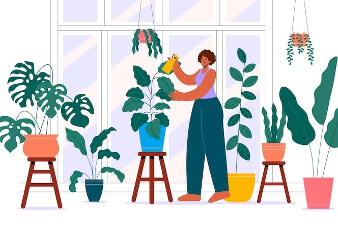 Platte vrouw die voor planten zorgt