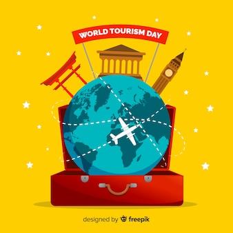 Platte wereld toerisme dag in een bagage
