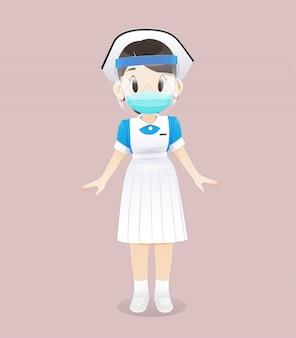 Pleegstudent die een medisch masker of een chirurgisch masker en een gelaatsscherm draagt.
