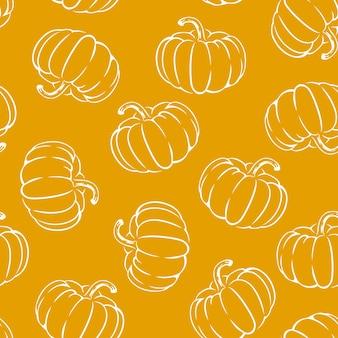 Pompoenen op oranje naadloze patroon als achtergrond.