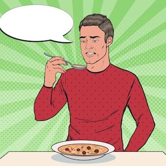 Pop art man proeverij soep met walgelijk gezicht. smakeloos eten.