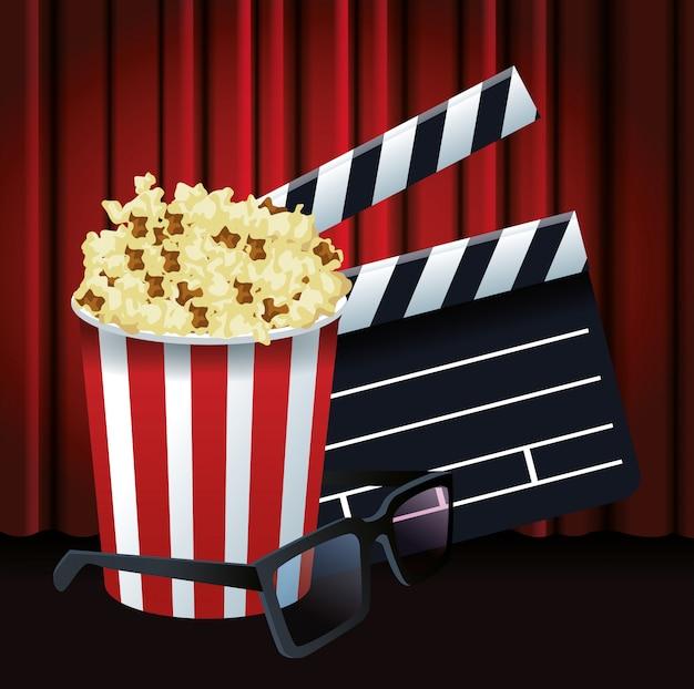 Pop corn emmer met duig en 3d bril over rode bioscoop gordijnen