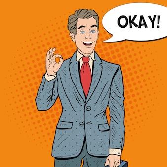 Popart gelukkig zakenman gebaren ok met komische tekstballon. zakelijk succes.