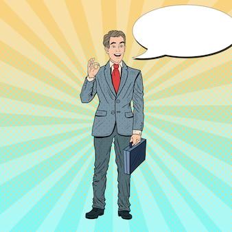 Popart lachende zakenman ok gebaren. zakelijk succes.