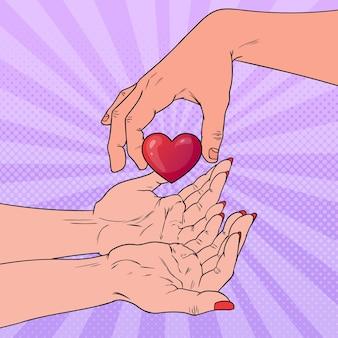 Popart liefdadigheid orgaandonatie concept. hand die hart geeft. gezondheidszorg, geneeskunde.