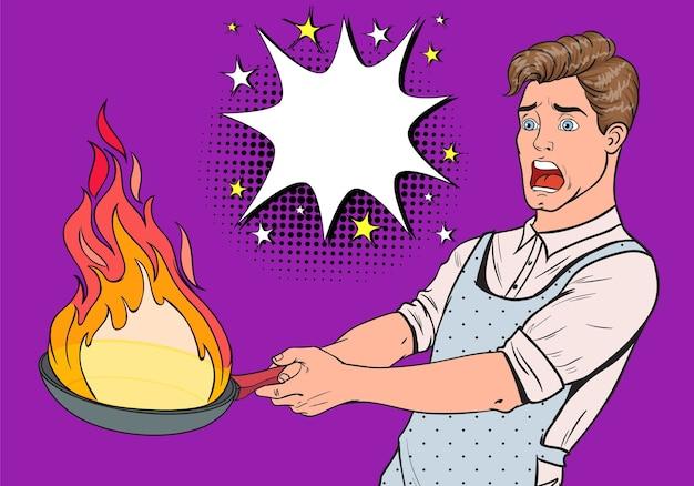 Popart man in de keuken met pan