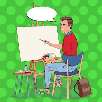 Popart mannelijke kunstenaar schilderij in de studio. man schilder in werkplaats.