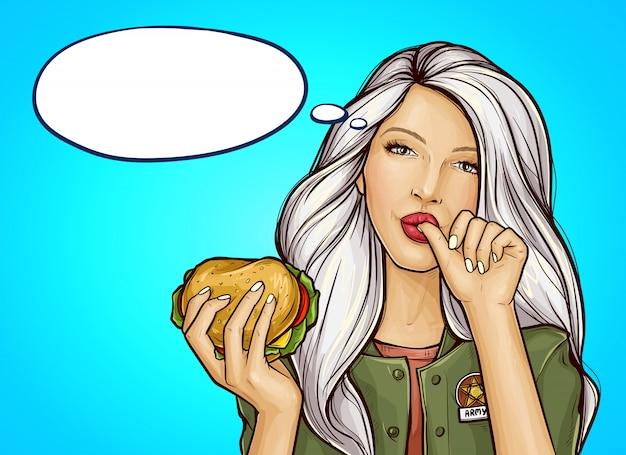 Popart meisje met hamburger likt een vinger