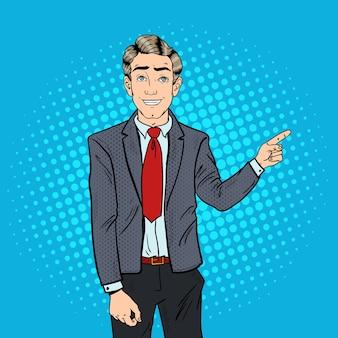 Popart succesvolle zakenman wijzende vinger op kopie ruimte. zakelijke presentatie.