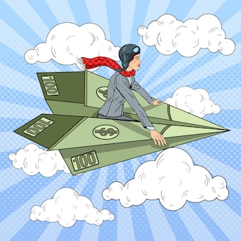 Popart succesvolle zakenvrouw vliegen op dollar papieren vliegtuigje.