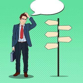 Popart twijfelachtige zakenman op kruispunt aanwijzer teken.