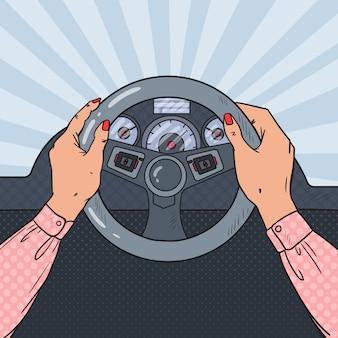 Popart vrouw handen op autowiel