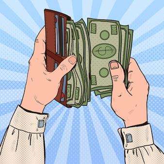 Popart zakenman handen met portemonnee met geld