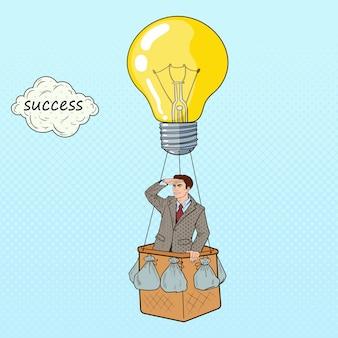 Popart zakenman vliegen in hete luchtballon op zoek naar succes.