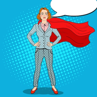 Popart zelfverzekerde zakenvrouw super held in pak met rode cape.