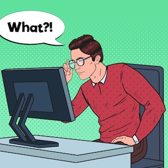 Popart zwakogige jongeman in brillen werken op de computer