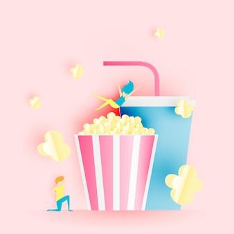 Popcorn en frisdrank in papieren kunststijl
