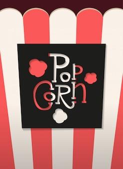 Popcorn gesneden zwarte letters etiket met schaduw op gestreepte popcorn verpakking.