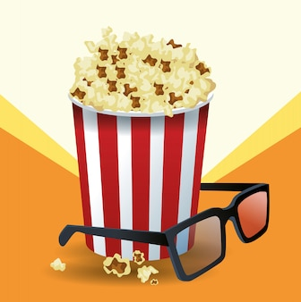Popcornemmer en 3d glazen over sinaasappel en wit