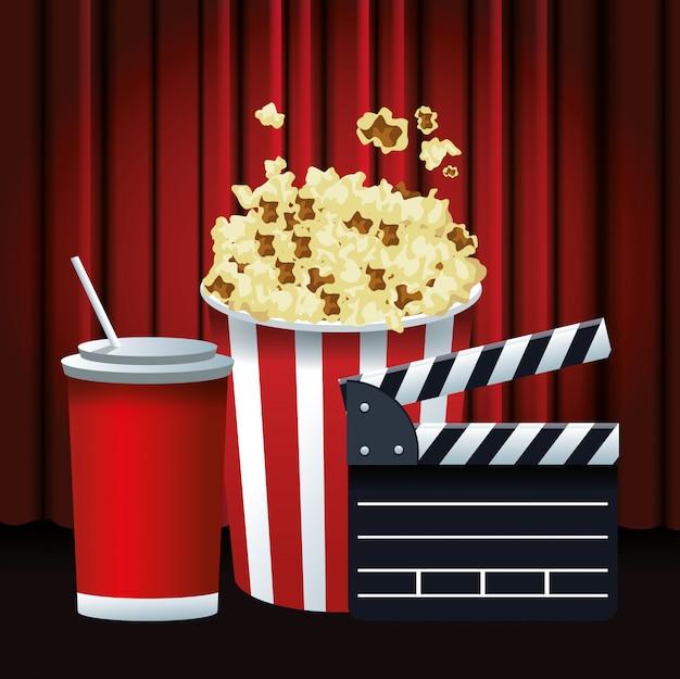 Popcornemmer met sodakop en dakspaan over rode bioscoopgordijnen