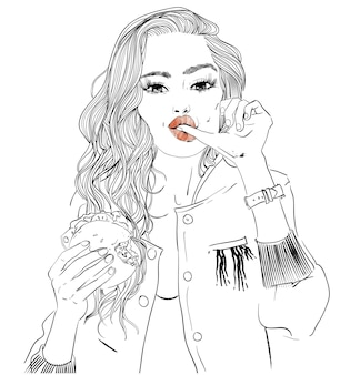 Portret van een jonge vrouw met hamburger in haar handen