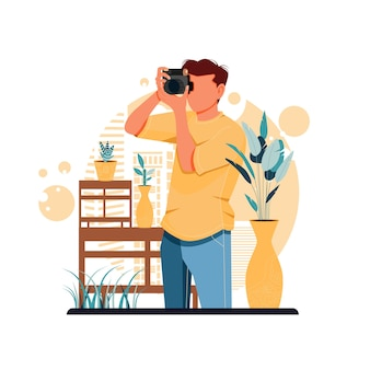 Portret van een jongen die foto's neemt met een digitale camera