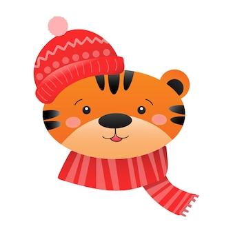 Portret van een schattige tijger in een winter gebreide muts en sjaal childrens nieuwjaar of kerstmis