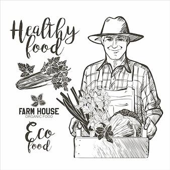 Portret van een volwassen boer met een houten kist vol met verse groenten en kruiden