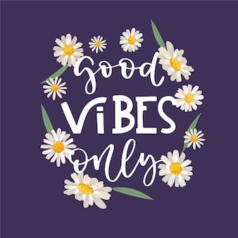 Positieve belettering goede vibes alleen bericht met bloemen achtergrond