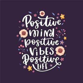 Positieve letters met bloemen achtergrond