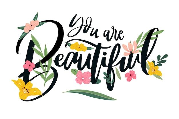Positieve letters met bloemen