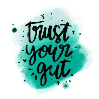 Positieve letters vertrouwen op uw darm bericht op aquarel vlek