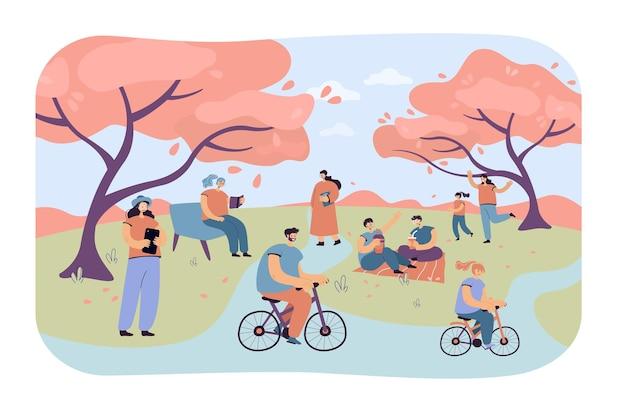 Positieve mensen zitten in stadspark met kersenbomen geïsoleerde vlakke afbeelding