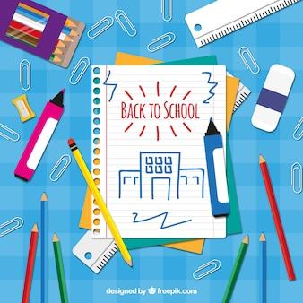 Potloden en markeringen met notitieboekje papier