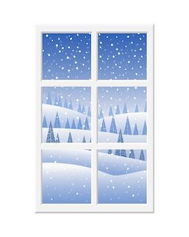 Prachtig uitzicht vanuit het raam met een wit frame op het besneeuwde winterlandschap
