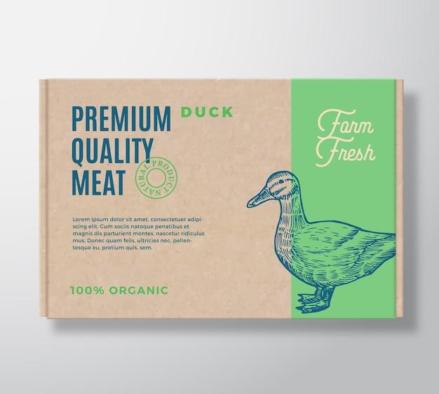 Premium kwaliteit eend vlees verpakking label op een ambachtelijke kartonnen doos.