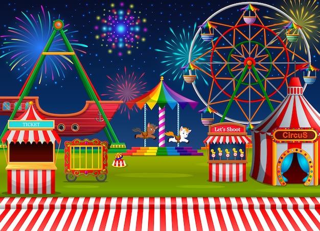 Pretpark scene met circustent en vuurwerk