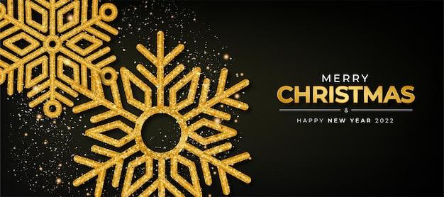 Prettige kerstdagen en gelukkig nieuwjaar 2022 achtergrond met gouden sneeuwvlok