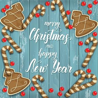 Prettige kerstdagen en gelukkig nieuwjaar achtergrond, feestelijke peperkoek, kralen en groet inscriptie op blauw hout