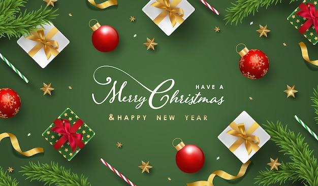 Prettige kerstdagen en gelukkig nieuwjaar achtergrond met realistische feestelijke objecten