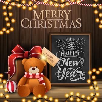 Prettige kerstdagen en gelukkig nieuwjaar ansichtkaart met gezellig interieur met houten muur