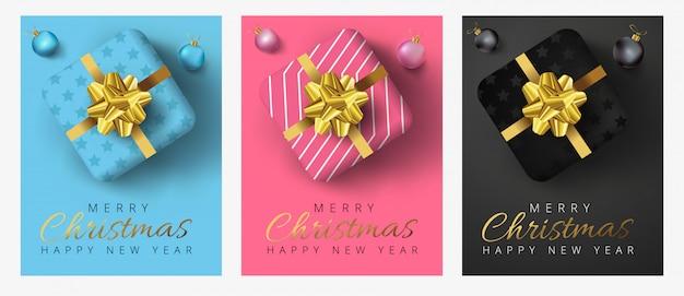 Prettige kerstdagen en gelukkig nieuwjaar belettering, realistische geschenkdozen