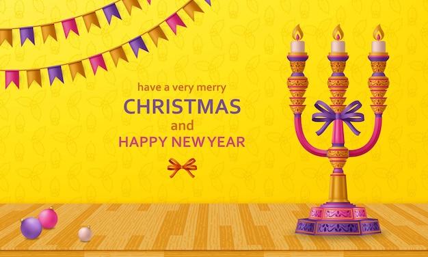 Prettige kerstdagen en gelukkig nieuwjaar gouden ballen, kandelaar en slingers.
