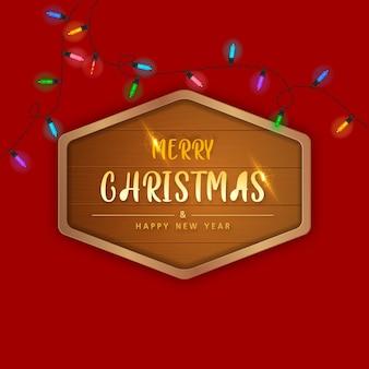 Prettige kerstdagen en gelukkig nieuwjaar in houten frame op rode achtergrond.