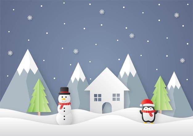 Prettige kerstdagen en gelukkig nieuwjaar papier gesneden kaart met sneeuwpop en pinguïns op blauwe achtergrond
